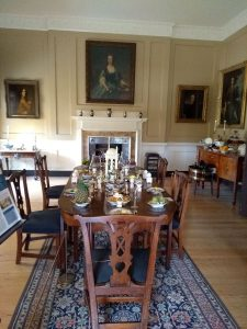 The dining room, with the table laid for dinner.