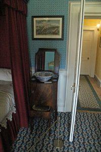 Gentleman's bedroom with wash stand.